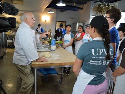 Luminari's Camp Delicious donates meals to EECM