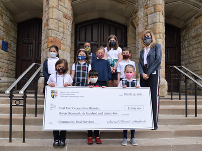 BIG-HEARTED SACRED HEART STUDENTS PRESENT BIG CHECK TO EECM