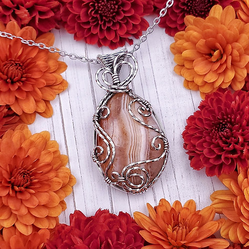 Red/Orange Banded Agate Pendant in Swirly Silver Frame