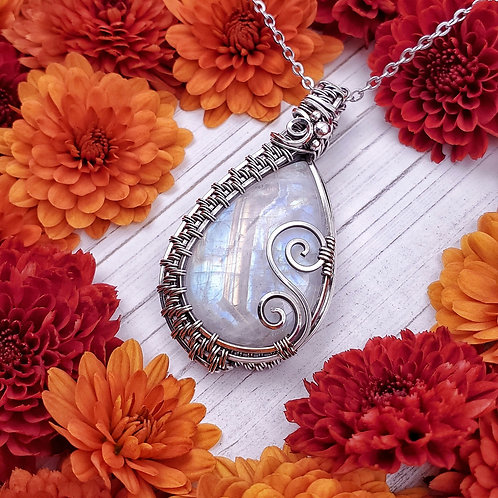 Rainbow Moonstone Pendant in Woven Silver Frame