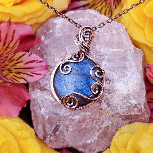 Flashy Blue Labradorite Circle Pendant in Swirly Copper Frame