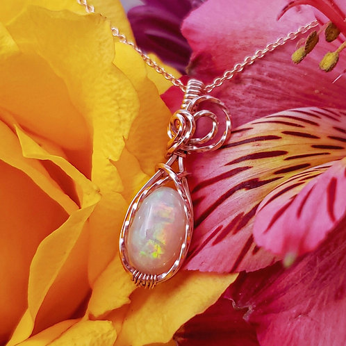Ethiopian Opal Pendant in Twisted Rose Gold Frame