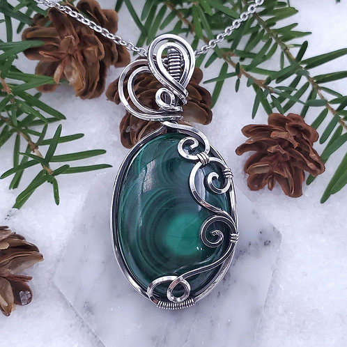 Malachite Pendant in a Swirly Silver Frame