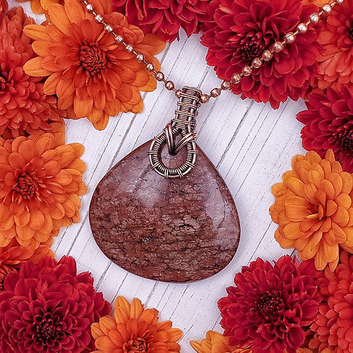 Maroon Stone Pendant with a Woven Copper Bail