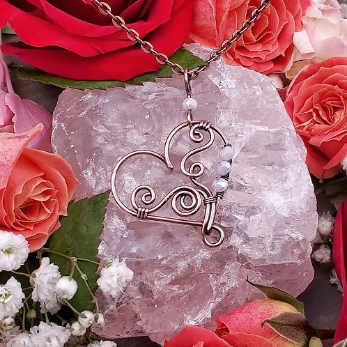 Swirly Copper Heart Pendant with Pale Pink Crystal Accents