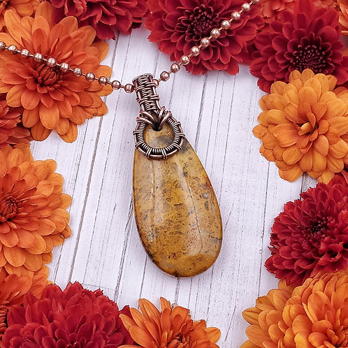 Yellow Crazy Lace Agate in a Woven Copper Bail