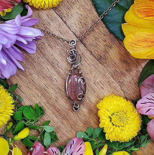 Sparkly Sunstone Pendant in Swirly Copper Frame