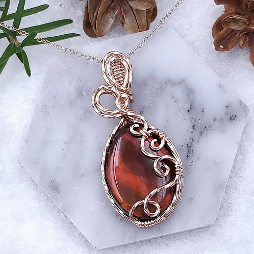 Genuine Firey Red Ammolite Pendant in a Swirly Rose Gold Frame