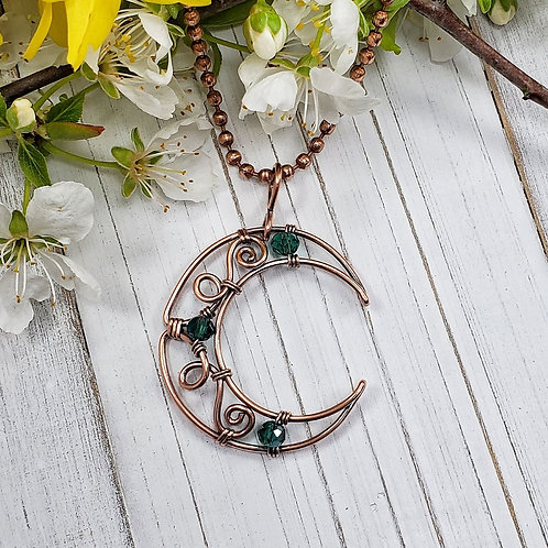 Swirly Crescent Moon in Copper with Teal Green Crystal Accents