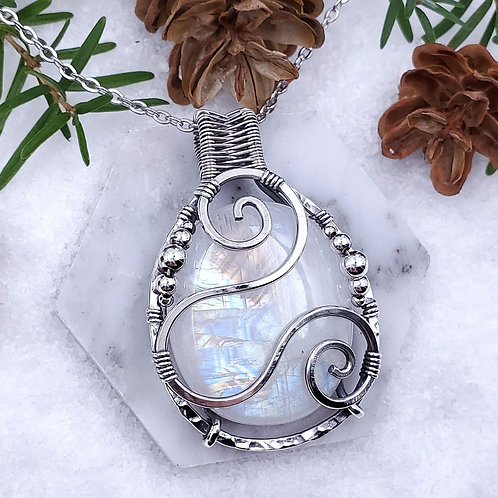 Rainbow Moonstone Pendant in Hammered Silver Frame