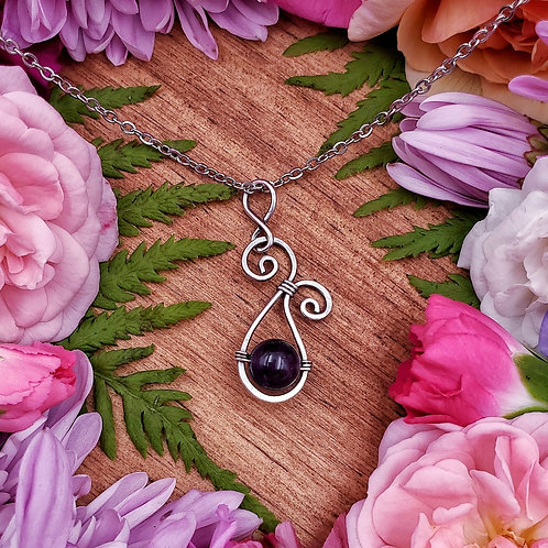Amethyst Pendant in a Swirly Hammered Silver Frame