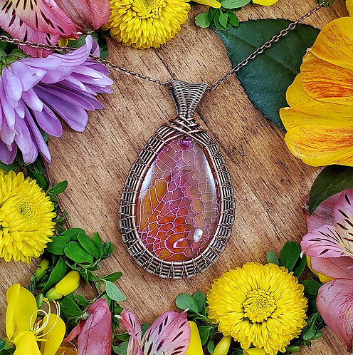 Dragon's Vein Agate Pendant in Woven Copper Frame