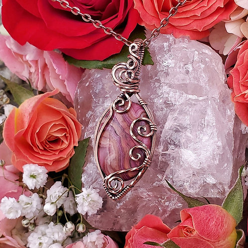 Pink Crazy Lace Agate Pendant in Swirly Copper Frame