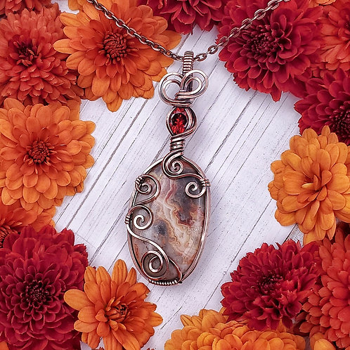 Crazy Lace Agate and Ruby Red Cubic Zirconia Pendant in Swirly Copper Frame