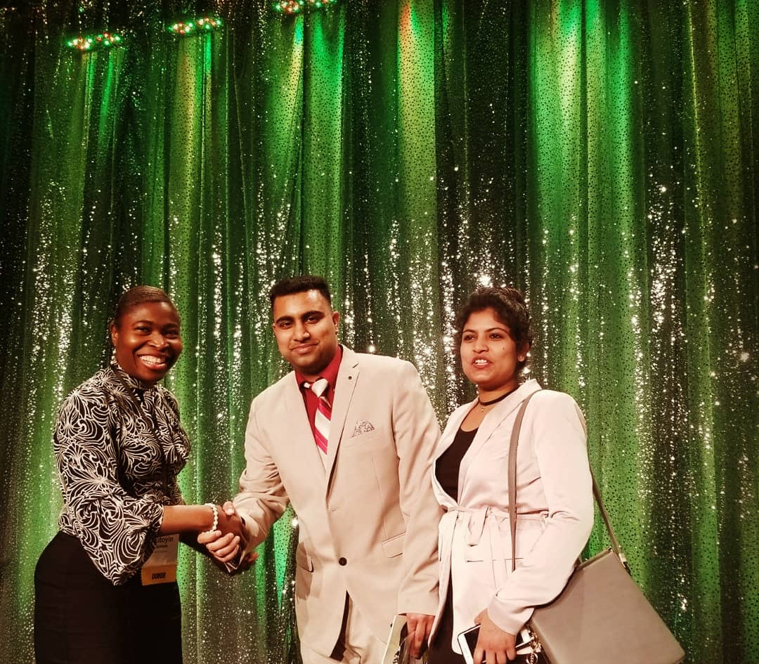 Dr Olu presents casa Scholarships to Centinel College Recipient