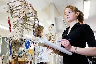 medical_student_studying_skeleton.jpg
