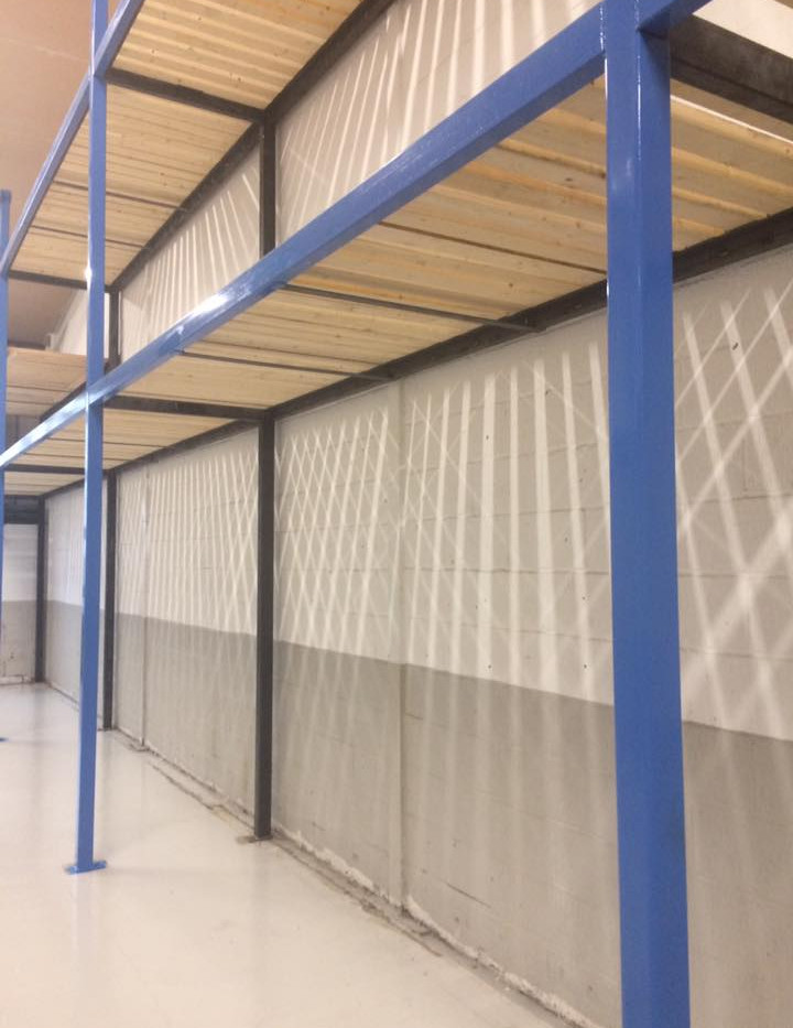 Large refurbishment of industrial unit. Steel frames and new wooden shelving