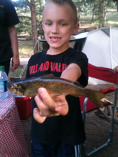 Austin Rohrbach with his first trout.jpg