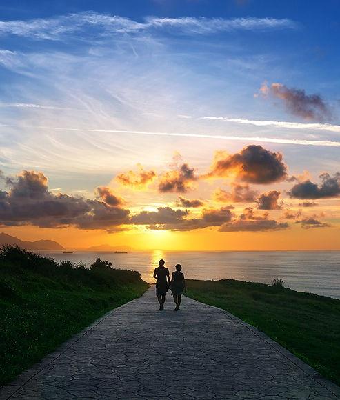 couple-walking-sunset-beach-path.jpg