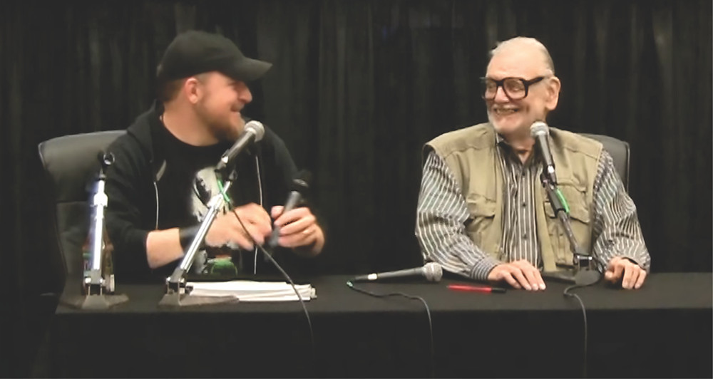 Brian Steward & George A. Romero with too many mics at a panel in Texas.