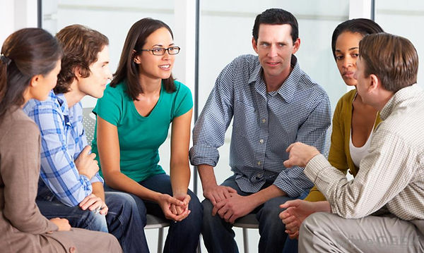 group-of-people-in-therapy-talking.jpg