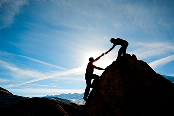Two-people-climbing-mountain-Managing-Mo