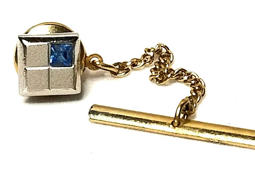 Designer by Swank, tie tack, blue rhinestone, silver tone and gold tone.