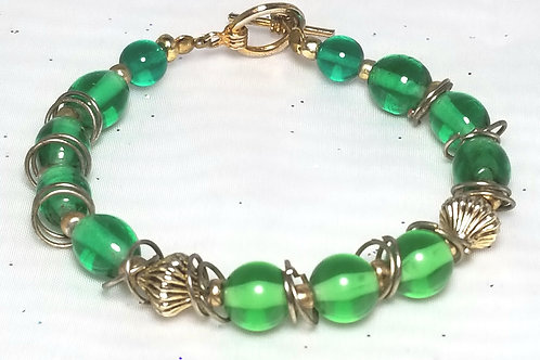 Designer by provenance, bracelet, green oval beads with gold tone setting