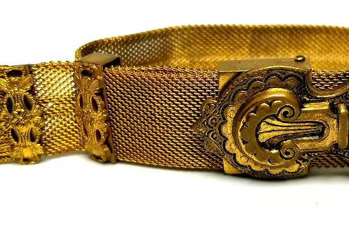 Designer by provenance, bracelet, adjustable gold tone mesh, ornate buckle.