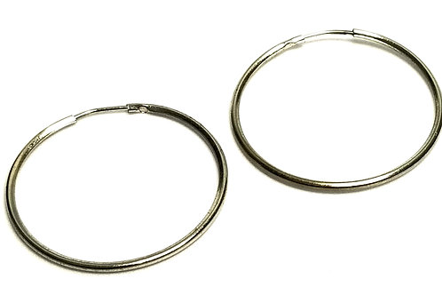 Designer by provenance, earrings, pierced hoops, silver tone, 1 1/4 inches.