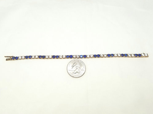 Bracelet, tennis style, blue and clear crystals in gold tone pot metal