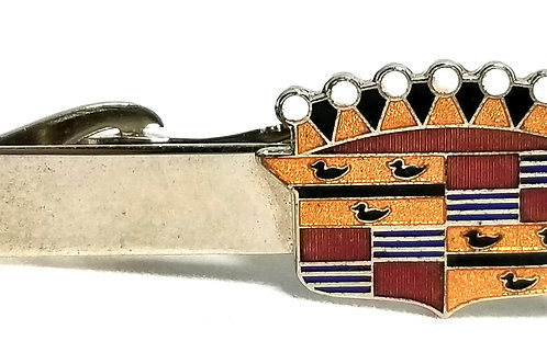 Designer by Kinney Co., tie clip, Cadillac motif, gold tone, 5/8 x 1 3/4 inches.