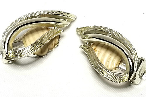 Designer By Sarah Cov, earrings, clip on, flame motif in silver tone.