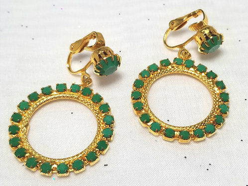 Designer by provenance, earrings, green faceted cabochons clip on dangles