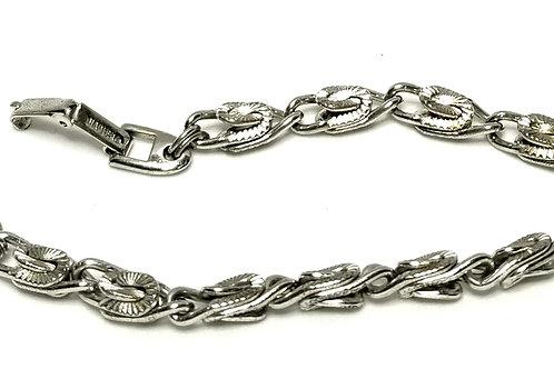 Designer by Napier, bracelet, silver tone 7 1/2 inches.