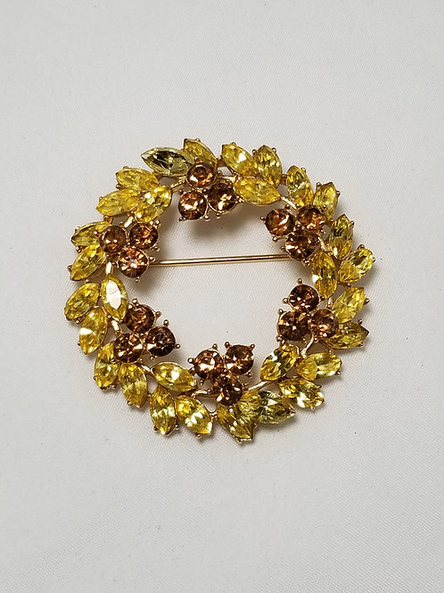 Crown Trifari, lemon yellow and brown crystals gold tone brooch, 2 inches