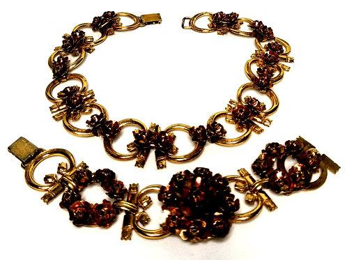 Designer by Monet, set, choker necklace and bracelet, flower motif, gold tone.