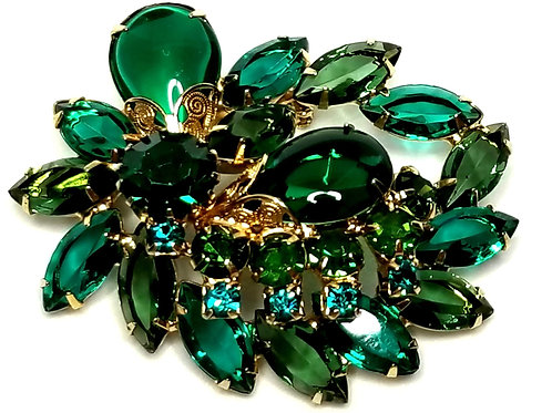 Designer by provenance, brooch, green marquise stones, blue round stones.