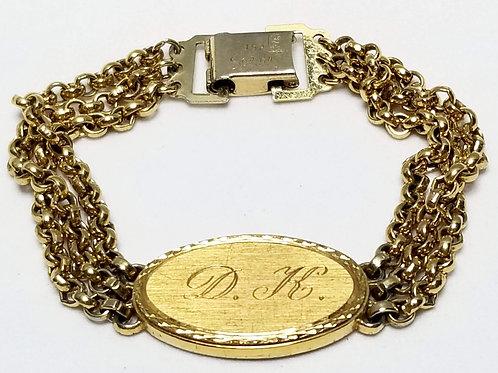 Designer by Spiedel, bracelet, initials DK, gold tone pot metal.