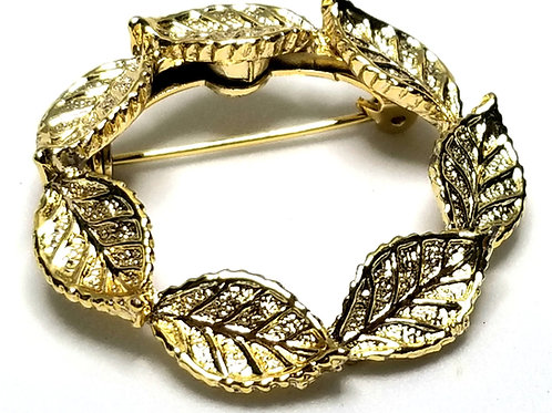 Designer by Gerry, brooch, circle of leaves motif, gold tone, 1 3/8 inches.