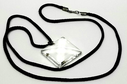 Designer by provenance, necklace, clear faceted glass pendant on black cord.