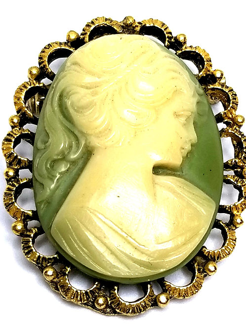 Designer by provenance, brooch, cameo motif, green and white oval, gold tone.