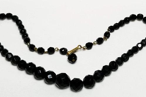 Designer by Laguna, necklace, black beads in gold tone pot metal.