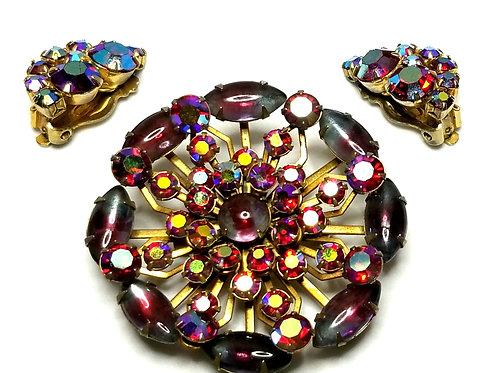 Designer by provenance, set, brooch, earrings, flower motif, purple stones.