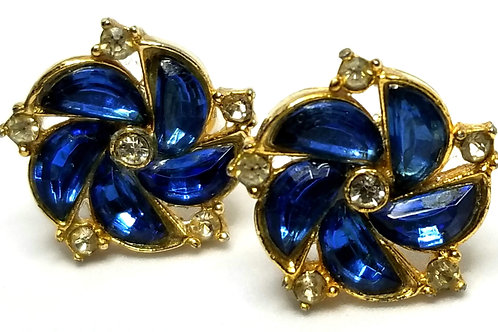 Designer by provenance, earrings, screw backs, blue faceted stones, gold tone.