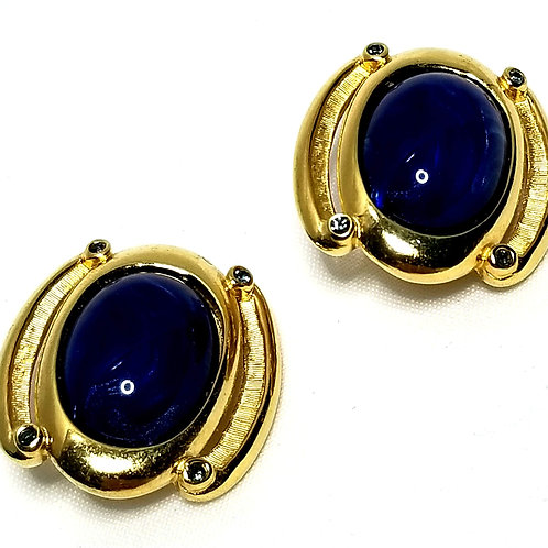 Designer by Trifari, earrings, clip on, blue oval glass cabochons in gold tone.