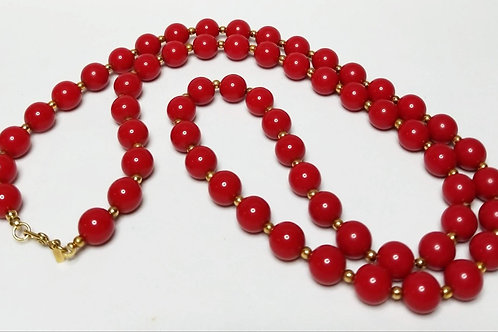 Designer by Monet, necklace, red beaded 30 inch with gold tone beads.