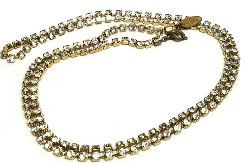 Designer by Miriam Haskell, necklace, clear rhinestones in gold tone, 30 inches.