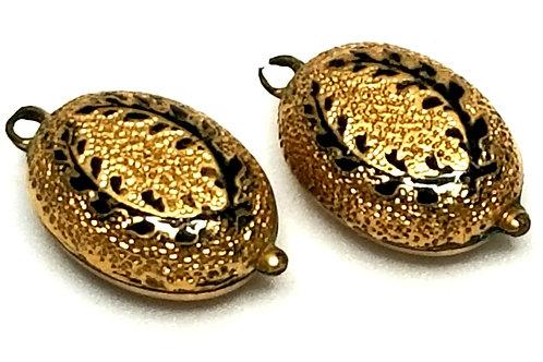 Designer by provenance, links (2) from bracelet, black inlay, gold tone.