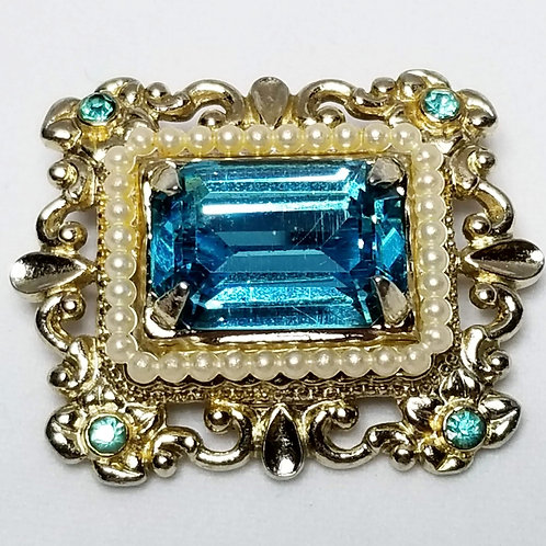 Designer by Coro, brooch, frame motif, blue faceted cabochon and rhinestones.